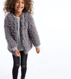 Ripped jeans and an amazing furry blazer to layer for your little girl #kidstylin #kidswear #kidspiration www.kidstylin.com