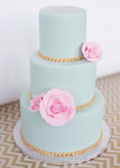 Pretty pink roses and gold beading adorn this mint masterpiece by Delicious Cakes.