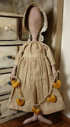 prairie doll --she used a wooden spoon for a pattern.