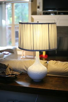Make your own lamp from a vase - Items Needed:  Vase  Lamp Kit  Lamp Harp  Drill  Ceramic Drill Bit  Screw driver  Box cutter or sharp knife  Painters tape  Light bulb