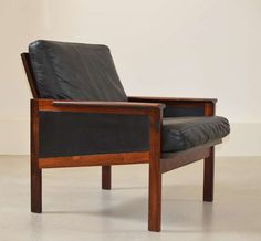 Rosewood and black leather Capella Series arm chair by Illum Wikkelsø | From a unique collection of antique and modern armchairs at https://www.1stdibs.com/furniture/seating/armchairs/