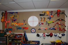Nerf Gun/Nerf Bow Organization....I needed a way to organize my son's Nerf items and vertical space worked well using peg boards. He loves the neat look of his arsenal, I love how he puts everything away.