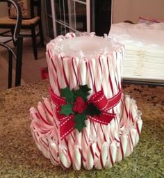 easy candy cane candle, take a candle and wrap any of your favorite candy cane flavors around it... and your done beautiful centerpiece by eve