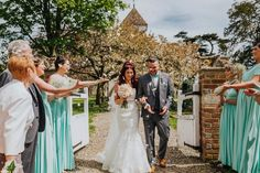 Just married! Walking out of the church in the grounds of @wasingpark, Berkshire, UK. Photo by Benjamin Stuart Photography #weddingphotography #wasingpark #justmarried #confetti #mintgreen #weddingday