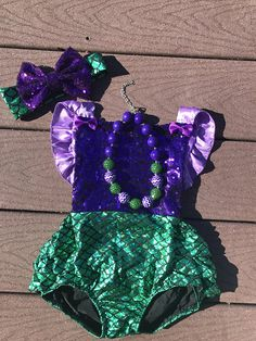 ADORABLE girls mermaid romper. This mermaid romper is perfect for your babys 1/2 birthday photo shoot, first birthday pictures, first birthday cake smash photo shoot, or just to wear every day for fun functions like summer BBQ. Whatever you choose for your little girl to wear for she is sure to look adorable. matching headband is available to add on at checkout. Please see the last photo in the listing for the headband. *barefoot sandals pictured are not included but can be added by visiting…