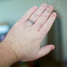 Wedding Ring Tattoo On Finger so cool for a guy that can't wear a ring due to a job or something