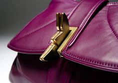 Close up butterfly lock open: Elegant purple calf napa leather luxury bag by Romana Correale. Unique butterfly lock. Handmade in Tuscany, Italy. #purple #butterfly #calfnapa #fashion #bag #leatherbag #design #beauty #madeinitaly #luxury #handbag #purse #madeintuscany #handmade #romanacorreale #leather