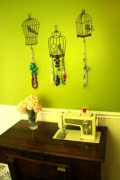 I dont like the pieces but like idea of lots of hanging things from bird cages.file away for the.future.