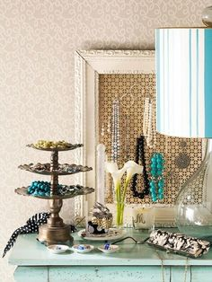 I love this idea of displacing jewerly on a corkboard covered with fabric in a frame!