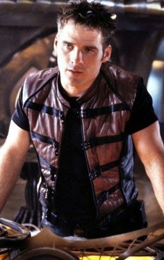 Presenting the most exceptionally designed John Crichton Farscape Leather Vest that highly admired to wear.  You can develop the astonishing fashion statement in this trendy season. Pick one now from our online store. #JohnCrichton #Farascape #LeatherVest #MenCollection #ChicOutfit