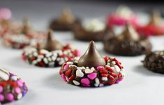 Chocolate #Valentine Kiss #Cookies ... such a pretty Valentine sweet treat! I am making them just so I can buy those heart sprinkles. I am in love with those little cuties!