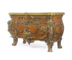 A large Rococo style gilt bronze-mounted satiné bombé commode Paris, circa 1900, after the celebrated model by Joahann Melchior Kambli |