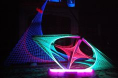 UV spider sculpture.  Create frame and wind round the neon wool.