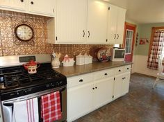 kitchen cupboards transformed, home decor, kitchen cabinets, kitchen design, painting, Then each door was primed and painted The color is vanilla custard and several coats of water based polyurethane were applied over the paint to protect the finish