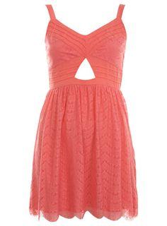 Pretty coral dress.