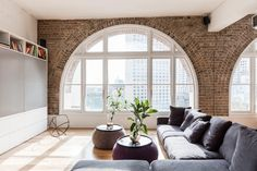 Josephine Hurley's converted warehouse apartment project showcases the original character of the space as a complement to modern furnishings and finishes.
