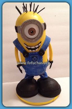 Inspired in Minion. My interpretation Fofucha Style.  This is a handmade doll. He is made using foam sheets She is about 10 inches weight of the decor is approx 08 oz. Is your child having a Minion theme party? Take a look at this fofucha doll. He can be an eye catching Centerpiece or caketopper. I can add your child's name at no additional cost. I can make custom fofuchas just get in contact with me.  see more of my work at www.facebook.com/fofuchashandmadedolls #Minions #Fofuchas…