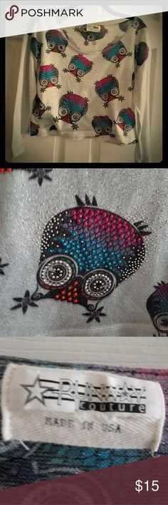 Upside Down Owl Midriff Top This is a polyester and metallic blend, midriff & quarter length shirt. The colors are bright. It has a little bling and lots of sparkle! Fits small/medium Runway Couture Tops Blouses