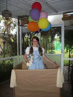 Make a photo prop station from cardboard box with balloons over top for the wizards hot air balloon