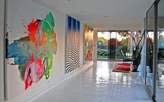 Graffiti painted canvases add color to the contemporary entry [From: Dana Nichols]
