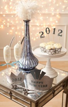 New Years Eve Tablescape Centerpiece www.tablescapesbydesign.com https://www.facebook.com/pages/Tablescapes-By-Design/129811416695