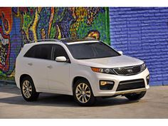 The 2012 Kia Sorento has already been supplanted by the 2013 model. But differences are mainly in packaging. Cute Small Cars, Cute Cars, American Graffiti, Harrison Ford, Funny Looking Cars, Hot Pink Cars, Cute Car Decals, Car Dates, Hello Kitty Car