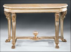 Empire style carved wood console with antiqued goldleaf and ivory finish, Valencia marble top with beveled edge.