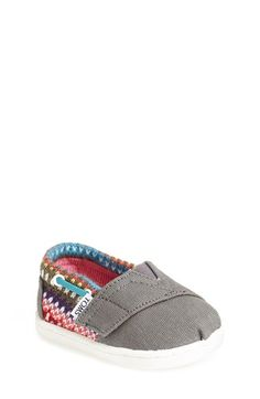 Free shipping and returns on TOMS 'Bimini - Tiny' Slip-On (Baby, Walker & Toddler) at Nordstrom.com. A stripe-patterned knit provides a soft, cold-weather update to a comfy canvas slip-on crafted with wraparound laces and a hook-and-loop closure. Since Blake Mycoskie started TOMS in 2006, the company has given away 10 million shoes to children in need across the globe through sales of their now-iconic slip-on shoes and the 1 for 1 donation program.