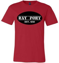 "Bay Port, one of the small villages that dot the Saginaw Bay shoreline. Home of the Bay Port Fish Company and the Annual Bay Port Fish Sandwich festival. This ""T"" is made from light, high quality cotton. Runs slightly longer than regular shirts. 4.2 oz, 100% combed ring-spun cotton jersey. Supremely soft, superior quality. Modern, slightly fitted shape. Made in the USA. Sizes Small thru 3XL in Red only"