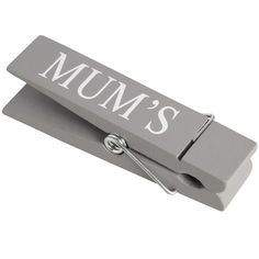 A simple novelty piece with practical application in grey wood with white lettering.