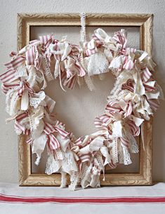 This rag wreath provides a farmhouse feel. Make Valentine's Day extra special with these Valentine crafts picked by Nana. 10 ideas that help you celebrate your special day with something handmade. Couronne Shabby Chic, Shabby Chic Kranz, Shabby Chic Zimmer, Shabby Chic Mode, Shabby Chic Wreath, Shabby Chic Crafts, Shabby Chic Style, Valentine Day Wreaths, Valentines Day Decorations