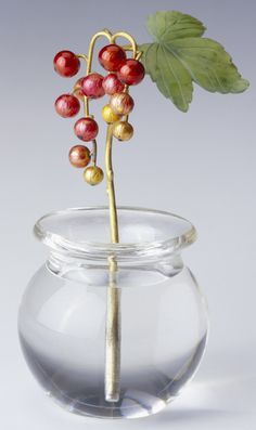 Fabergé redcurrant flower study, the sprig of redcurrant in two bunches consisting of 13 berries enameled in red, orange and yellow; one set of three nephrite leaves, all attached to yellow gold stalks and set in a circular rock crystal vase with flared lip. Circa 1900. Probably acquired by Queen Alexandra.