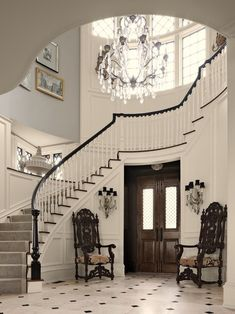 Curved (organic) Lines Dominating  -stairs  -chandelier  -ceiling