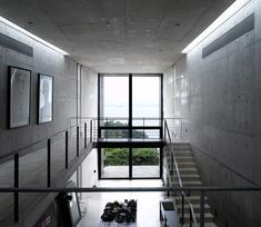 http://www.dezeen.com/2011/09/20/house-in-sri-lanka-by-tadao-ando-photographed-by-edmund-sumner/   Awesome all-concrete building.
