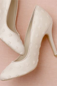 """Floret Heels     For a romantic twist on a classic stiletto look no further than this ivory satin pair, overlaid with dreamy tulle embroidered with dainty white blossoms. Satin and tulle upper; leather sole. 4"""" satin-wrapped heel. Imported."""