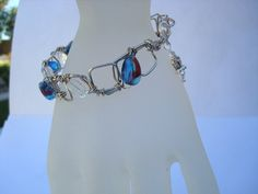 Bracelet Blue Clear with a hint of Red Wire by CrookedCrystal, $12.50