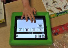 (Jahi Chikwendiu/ WASHINGTON POST ) - Steven Moshuris, an autistic student atBelle View Elementary, uses an iPad asa communication device.
