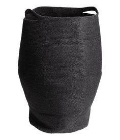 Black. Laundry basket in jute with two handles. Diameter approx. 13 3/4 in., height 25 1/2 in.