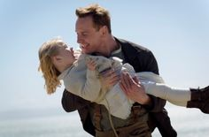 """Michael Fassbender (as Tom Sherbourne) and Florence Clery (as Lucy) in """"The Light Between Oceans"""" (2016)"""
