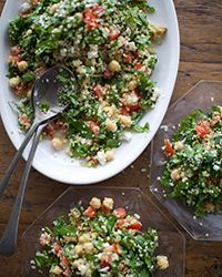 A colorful salad of fluffy quinoa, chickpeas, spinach and feta make a terrific summer side dish or a vegetarian main course all on its own.