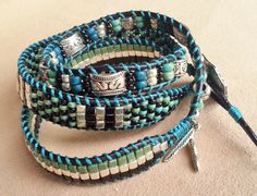 Tri-color 3-wrap with feather charms  $34