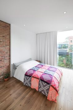 Minimalist Bedroom In Montreal Apartment Renovated By Canadian Designer Anne Sophie Goneau Exposed Brick And A Mive Window Leave The E Feeling