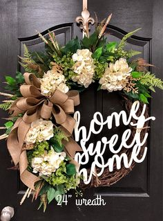 This Exclusive BEST SELLING wreath can only be found here at FleursDeLavie! Gorgeous Elegant Year Round Door Wreath! Perfect for greeting your guests to your home with this one of a kind door wreath. Show on an 18 grapevine wreath with moss, mixed flowing greenery of ivies, boxwood,