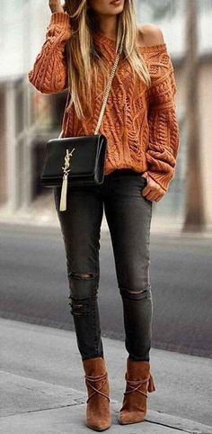 women's chunky knit off-the-shoulder sweater with dark ripped jeans, brown suede booties and classic Yves Saint Laurent crossbody bag. #style #outfits #fall