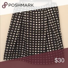 Knee-length silky skirt with pleats (Large Petite) The Limited Skirt | Lightweight structured skirt with two pleats in the front and back. Great for work in all seasons! 100% poly. The Limited Skirts A-Line or Full