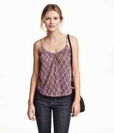 Flared camisole top in soft patterned jersey with a V-neck front and back. Narrow shoulder straps.