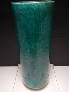 For your consideration is a superb vintage mid century modern original Guido Gambone sea breeze green and blue egg plant glaze cylindrical shape vase. This rare and unique hard to find mid century modern Italian studio pottery vase is in great vintage condition. Marked at the base with high relief numbers and incised Italy export base mark with auction house tag . This rare and unique top quality mid century Guido Gambone vase will make a great focal point to your mid century modern home…
