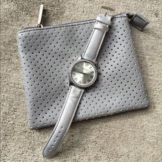 """Geneva watch and makeup bag Silver, diamond Geneva watch. Throwing in a 5""""x6"""" make-up bag/mini """"clutch"""" just because it matches  no flaws! Watch and bag both have plastic, as shown in pictures. Band on watch is in perfect condition. Only tried on Geneva Accessories Watches"""