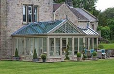 Exterior photo for dining and sitting. A conservatory painted in Flagstone, from Vale's conservatory paint collection.