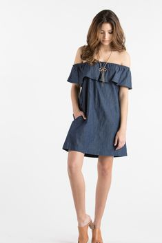 We have a soft spot for anything over the shoulder! This denim shift dress is no exception, especially with the...